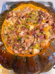 Here is a roasted pumpkin with fruit and nut stuffing - nuts, apricots, apples, celery and other vegetables. I also served a cornbread stuffing with roasted chestnuts.