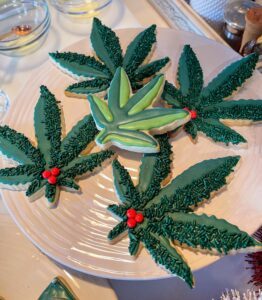 I decorated some cannabis leaves with red dots - a humorous take on holly.