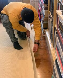 Rug pads come in a range of sizes, but they won't always match perfectly, so this padding is trimmed carefully with a knife.
