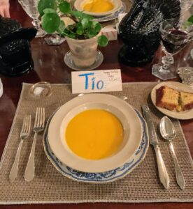 "The children made place cards for every guest. This is Kevin's seat at the table. My grandchildren, who are fluent in Spanish, call him ""tio"" which means uncle. We started with a bowl of warm butternut squash soup."