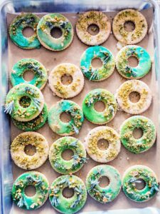 These are colored green and include finely chopped pistachios. In the recipe, we also use candied ginger, citrus and sugared flowers.