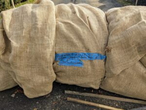 The burlap gets reused from year to year whenever possible. When it is removed in spring, it is rolled up, labeled and then stored in the dry trailer barn until it is used again.