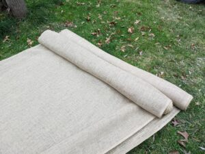 Because the burlap comes in 48-inch wide and 60-inch wide rolls, it's necessary to sew lengths of burlap, so it is wide enough to cover the boxwood. Burlap is relatively inexpensive and available at garden centers.