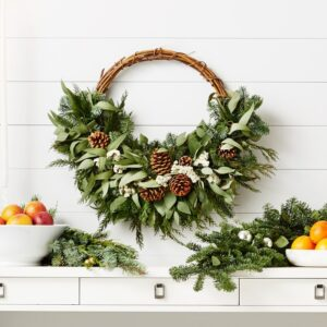This is my Martha Stewart Wintry Asymmetrical Half Wreath at Williams Sonoma. It is 24-inches and features sweeping greenery on one side and an exposed twig base on the other. It's expertly hand arranged with fresh and air-dried botanicals grown in the United States.