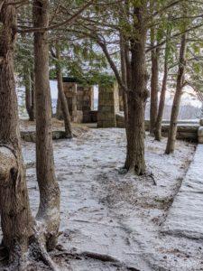 This photo shows the charming Ox Ledge gazebo through the trees.