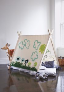 """With everyone spending more time at home, make a creative and fun hideaway teepee for the children using paintable canvas. The easy how-to for this artistic project is in the book, """"Martha Stewart's Very Good Things."""""""