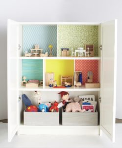 Have an old unused cabinet? Convert its shelves into a dollhouse with some foam board inserts and decorative paper - it's a great way to reuse and repurpose.