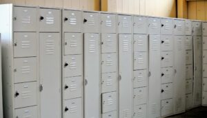 In the back corner, we have this bank of lockers for the crew. Everyone has their own set of lockers, where they can store safety equipment, extra shoes, clothing, and other personal items.