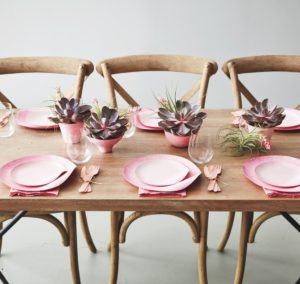 To make any special gathering more festive, dip-dye bamboo and reed plates in food-safe coloring to create a unique ombre table scape.