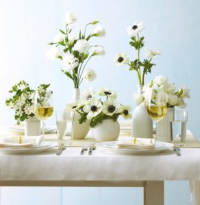 When entertaining, gather assorted glass bottles and vases and give the insides a few coats of white matte spray paint to create a faux porcelain look. They'll look so beautiful with cut flowers.