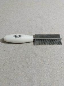 We use a variety of combs and pin brushes to remove any knots or tangles. This is my 2-in-1 detangle comb. The dual sided comb is so light and easy to use, and gets out tangles and dander, and makes grooming quick. It's great for cats and dogs.