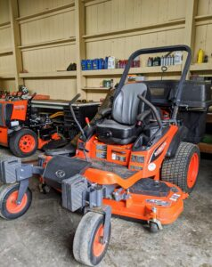 On this side of the Barn, we keep our fleet of Kubota mowers. They are all parked by the back entrance to the barn during the summer season when they are used daily.