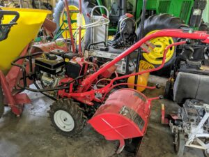 """On the opposite side of the Barn - lots of walk-behind power equipment. This is our Troy-Bilt """"Big Red"""" Garden Tiller. Troy-Bilt introduced the first residential rototiller in 1937 and now has several rugged and reliable models to fit every need. Rototilling is one method of turning up the soil before planting the garden."""