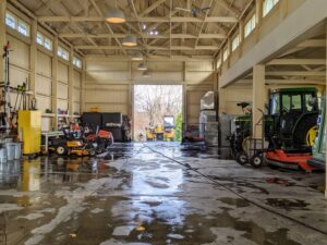 Here is a view of the inside. To clean it thoroughly, everything is brought out, the floor is cleaned and then everything is returned to its proper place. At night, this barn accommodates all our farm vehicles and equipment.