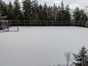 Here is the tennis court - look closely and one can barely see the white court lines beneath the snow.
