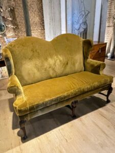 This is one of a pair of 1880 English George II style wingback sofas covered in Rodgers & Goffingon velvet upholstery.