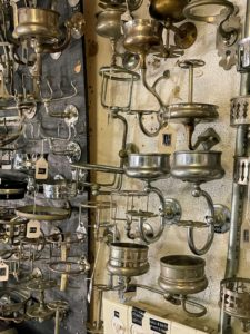 Here's a wall of nickel bathroom accessories - toothbrush holders and cup holders all from 1890 to 1920.