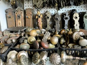 On another peg board are hundreds of doorknobs, doorplates, keyhole covers - some plain in design, some very ornate.