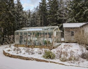 This is the small glass greenhouse. There is not enough room in this structure to store all the tropicals that decorate my terrace in summer, so those are all transported back to Bedford and kept in large temperature-controlled hoop houses. On the right - the wood shop and tractor garage.