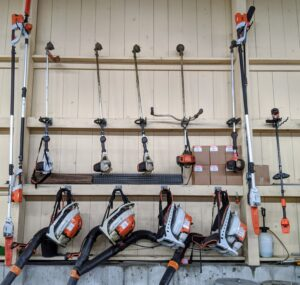 On this section of wall, we hang all the leaf blowers and weed-whackers, or string trimmers.