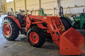 We keep our big Kubota tractor parked in the Equipment Barn also. This is my model M7060HD12 tractor. It is used every single day for transporting soil, mulch, heavy pots, multiple tools, organic debris and so much more. A tractor is essential to any working farm.