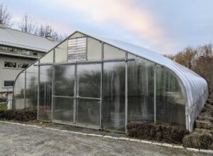 This greenhouse is located near my vegetable greenhouse and behind my giant Equipment Barn. I am so glad all my precious plants can be stored safely indoors during the winter where I can visit them and make sure they are doing well. And of course, I always look forward to when they can come out of hiding again in spring.
