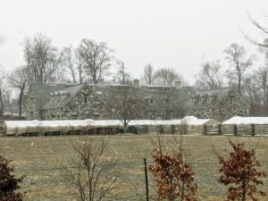 Here, one can see the snow falling across the paddock and over my stable and carriage house. The skies were very gray, and the forecast called for a light snow through the rest of the afternoon and into the night.