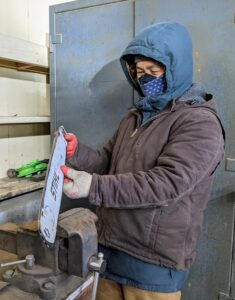 Chhiring stops frequently to check his work and to assess where else he needs to file. Here at the farm, we also wear masks at all times - adhering to all the CDC pandemic safety guidelines.