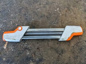 This is a STIHL 2-N-1 Easy File Chainsaw Chain Sharpener and Guide. It includes two round files, and one flat file, and comes with a unique file holder and filing guide for easy use.