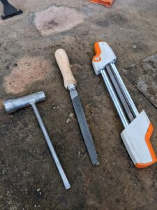 For sharpening the chainsaws, Chhiring needs a STIHL chainsaw scrench, which is a 3-in-1 multi tool wrench and screwdriver, a flat file, and a STIHL file guide.