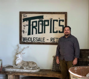 Here's Ryan, owner and president of The Tropics, Inc. Los Angeles, in front of the original sign. Now in its 49th year, Ryan's father, Ronald J. Hroziencik, started the business selling junk at a swap meet with his college roommate. Occasionally, they would have plants to sell, and customers loved them. And now, it's a successful establishment with a large inventory of unique and beautiful specimens.