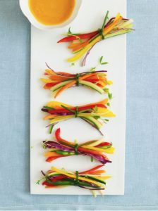 For a perfectly portioned and shareable appetizer, slice your veggies into thin strips and tie them into bundles with chives. Have some dip stationed nearby and these bright and beautiful bites will be devoured in no time.