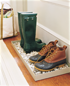 One of the top Good Things last month was this one - how to keep the rainy day messes contained. Fill a tray with gardening stones or pebbles to create a pleasing and purposeful drainage layer. Place the tray near the door and put wet, muddy boots there to dry as soon as you get home.
