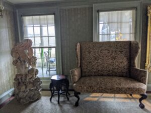 """On the other side, I had a gorgeous loveseat. Take a look at the March issue of """"Living"""" to see where this piece of furniture ended up."""