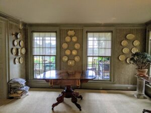 Here is another wall of plates – perfectly positioned between two floor-to-ceiling windows.
