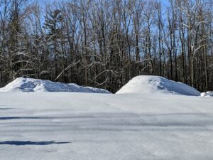 Are these snow mounds or compost piles? Actually, these are my compost piles covered in white tarps and glistening white snow.