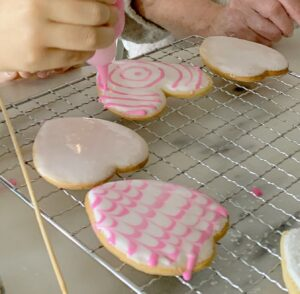 Jude and I decorated so many cookies. Jude is extremely artistic and creative. Here she is making a concentric circle pattern on a cookie before she uses her skewer to make the Napoleonic decoration.