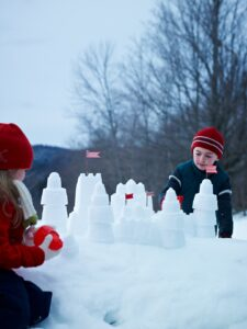 Here's a fun wintertime Good Thing for the children. Just take sand castle pails and build a frosty kingdom fit for the neighborhood snowmen!