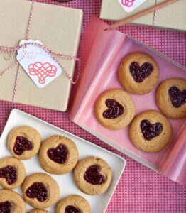 Are you making Valentine's Day cookies this weekend? If so, try these thumbprint cookies and give them a special upgrade by overlapping the indentations in the dough to create space for jam hearts.