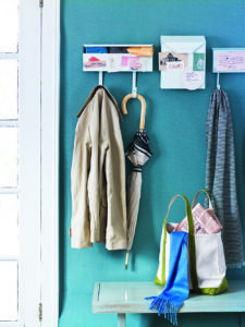 Among the good things in the book - using metal mailboxes, typically used for apartments and front porches, for use indoors. Those with hooks can be used to hang coats, bags and umbrellas. Plus, because they're magnetic, they can also hold notes and to-do lists.