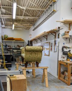When I went to Interiors Haberdashery to drop off a few more pieces of furniture, I saw the sofa on the sawhorses already well into its transformation process.