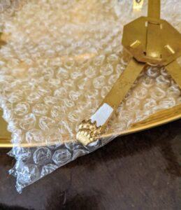 We also used these plate hangers from Martha by Mail. Anyone remember these or have some of their own?