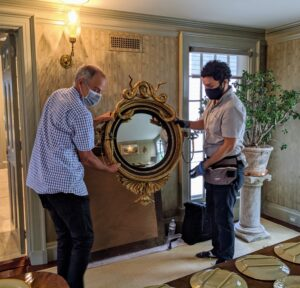 Here, David and Carlos from iLevel hang one of the mirrors in the room. And then check it for level – everything is always checked and double-checked for straightness.