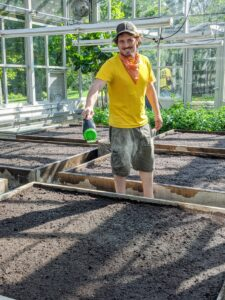 When setting up my vegetable greenhouse beds, Ryan uses Miracle-Gro's Performance Organic.