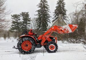 The day after a storm is always earmarked for clean-up. Here's Pete from my outdoor grounds crew driving our trusted Kubota tractor to pick up snow and move it from my driveway.