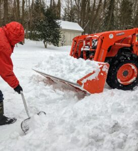 There is so much snow, we have to take it in bucket loads to another location. I am always grateful for all the equipment we have to use around the farm - this Kubota is used every day of the year.