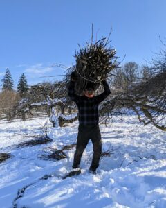 And here's Domi taking the rest of the branches to the truck. These branches will be chipped and reused in the garden later.