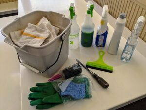 This bucket contains soaps and cleansers, gloves, sponges, a squeegee, etc. The lunchroom at my farm is kept tidy, but once a week, it's given a deep cleaning. Sanitizing reduces microbial counts to safe levels, and disinfecting aims to destroy harmful microbes and viruses.