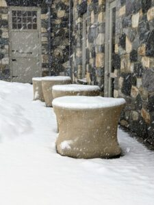 Down by the stable is the office building where my business manager, property director, and executive personal assistant work. In front of the building are these burlap-covered bird baths - the snow sits lightly on top, but the stone pieces are safe and dry inside.