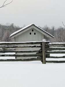 Walking back up toward my Winter house is the donkey paddock and their run-in shed. These run-ins are a must for any farm animal. They provide protection from bad weather such as rain, snow, wind and summer heat. I love how snow collects on this antique white spruce fencing in front. This fencing is what surrounds all my paddocks at the farm.